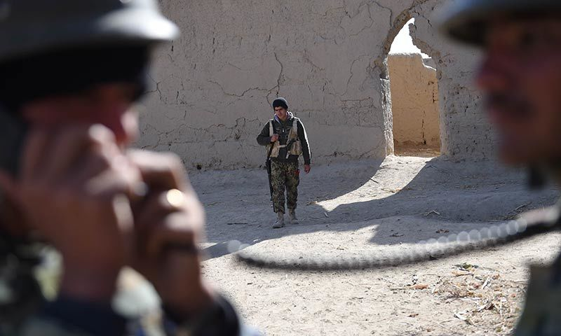 Afghan National Army soldiers patrol the compound of the mosque where Mullah Omar founded the Taliban movement 20 years ago. — AFP