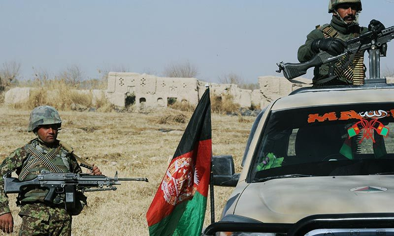 Afghan National Army soldiers keep watch near the remains of the house belonging to Mullah Omar . — AFP