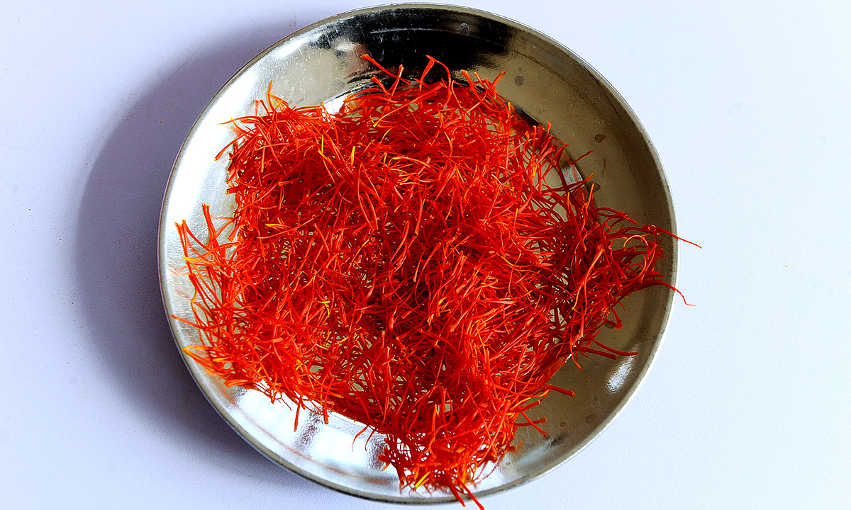 Cleaned saffron is arranged on a platter. - AFP