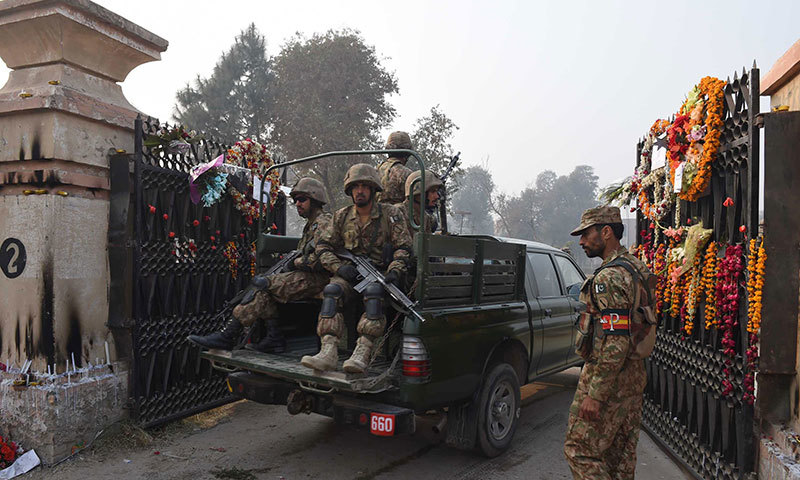 Pakistani soldiers enter the army-run school which was attacked by Taliban militants in Peshawar on December 19, 2014. – AFP