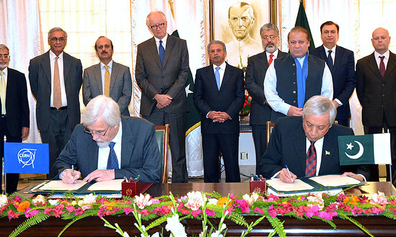 Prime Minister Nawaz Sharif witnesses the signing of an agreement with CERN at the PM House in Islamabad on Friday. – APP
