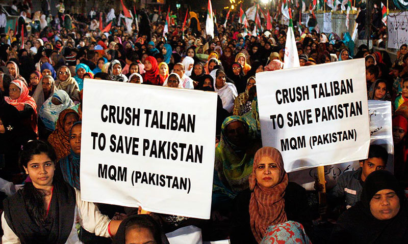 Activists of Muttahida Qaumi Movement (MQM) take part in a rally organised in solidarity with victims of Peshawar massacre in Karachi on Friday. – Online
