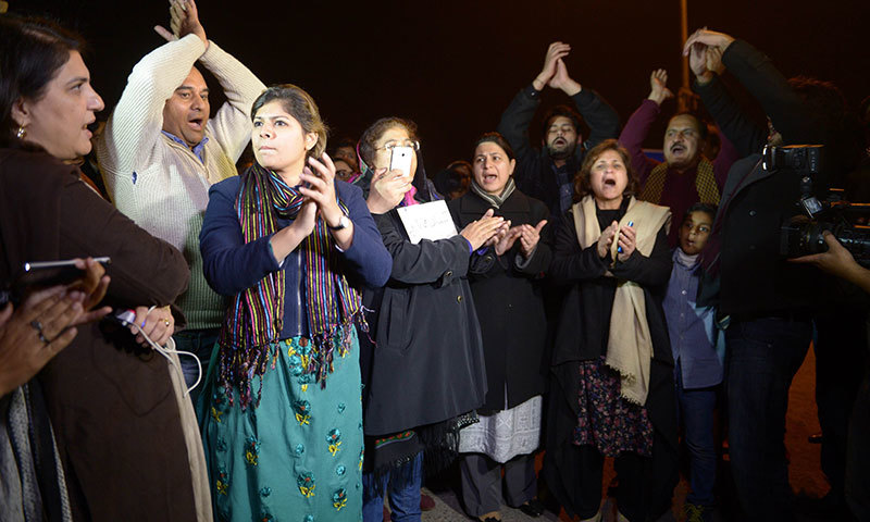 Civil society activists demonstrate in support of the Peshawar school massacre victims in front of Lal Masjid, after its cleric refused to condemn the massacre on a television talk-show, in Islamabad on December 19, 2014. - AFP