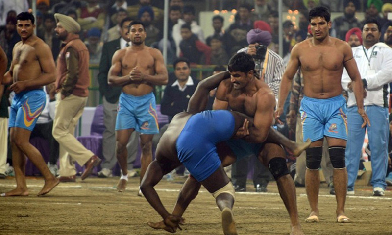 This picture shows two kabbadi players struggling to score a point for their teams. — AFP/File