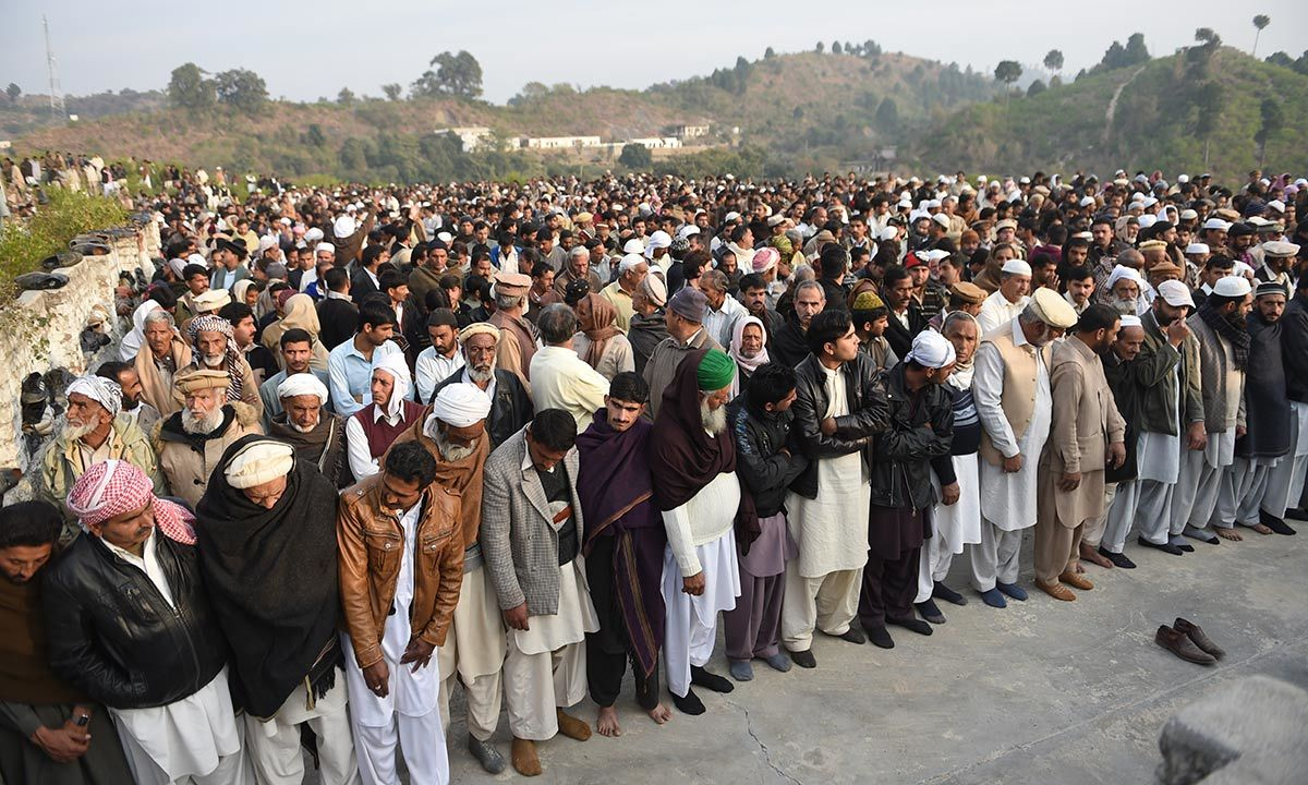People gathering at the funeral prayers of executed militant Arshad Mehmood. -AFP Photo