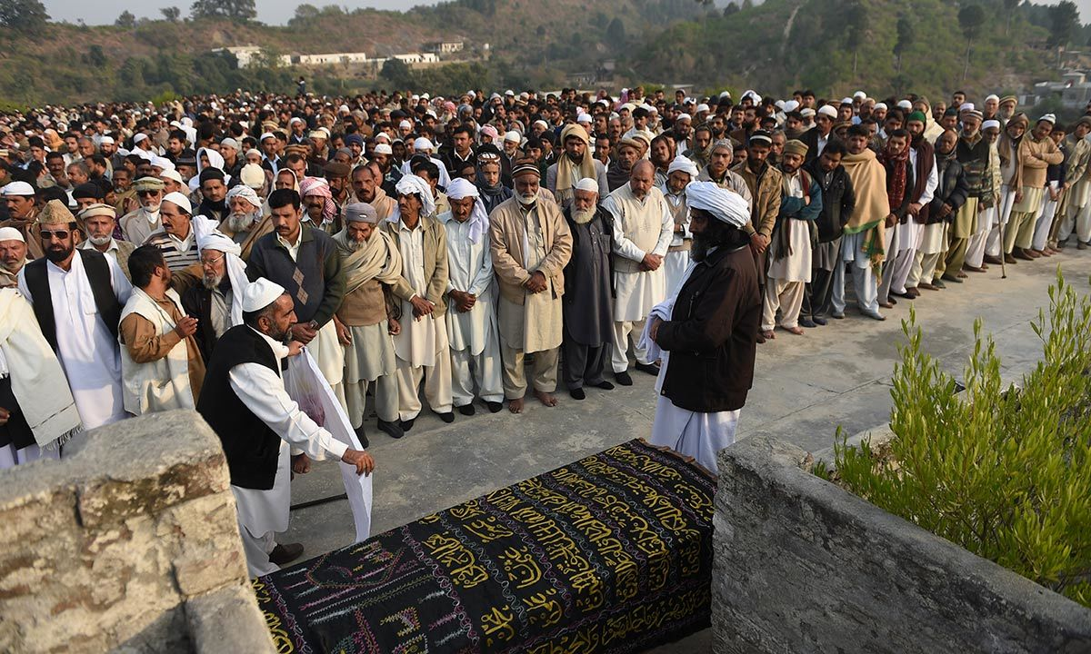Villagers at the funeral prayers of Arshad Mehmood. -AFP Photo