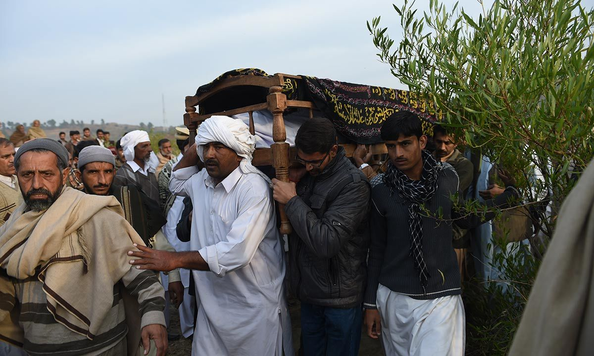 Villagers carrying the body of executed militant Arshad Mehmood. -AFP Photo