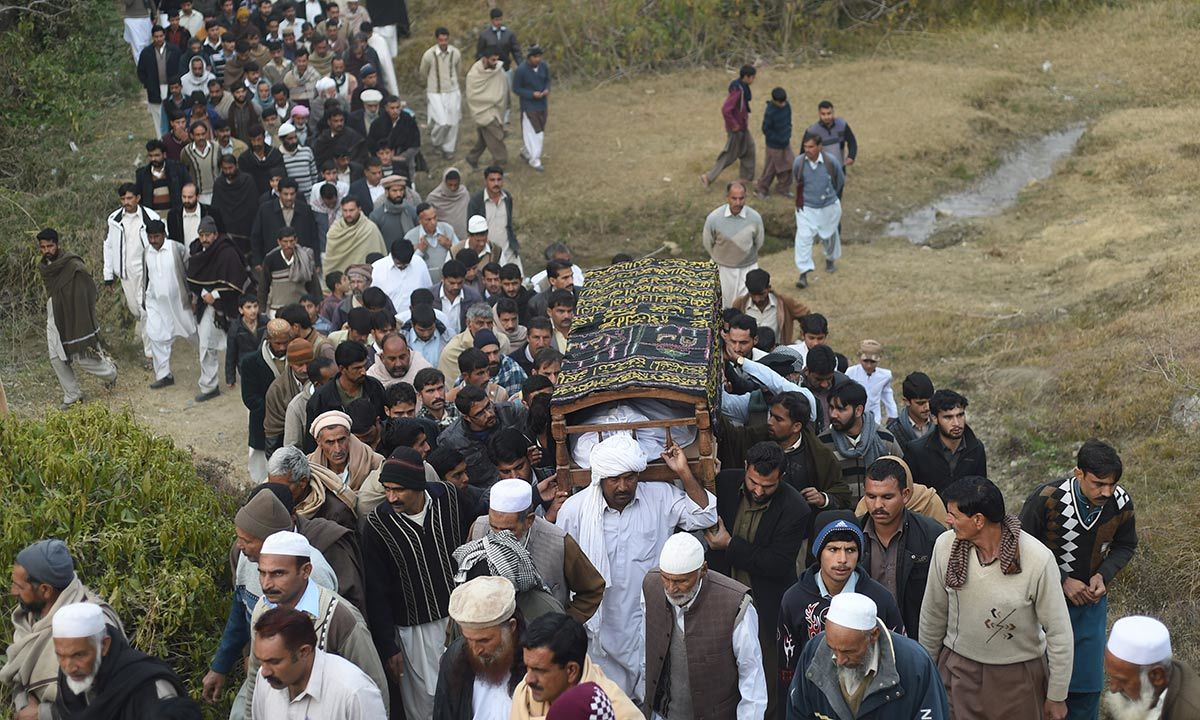 Villagers carrying the body of Arshad Mehmood in Javera village. -AFP Photo