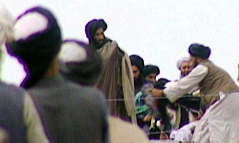 This television frame grab from 1996 taken secretly by BBC Newsnight shows Taliban's spiritual leader Mullah Mohammed Omar, center, in Kandahar in 1996. — AFP/file