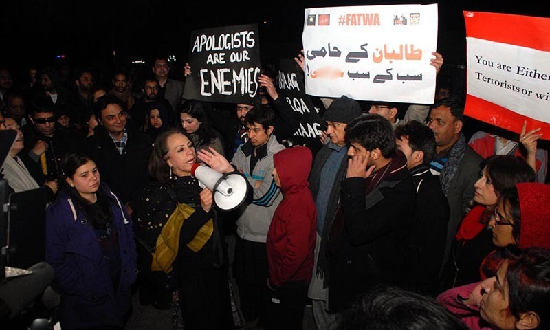 Activists of Civil Society hold a demonstration against the Peshawar incident outside Lal Masjid.— Online