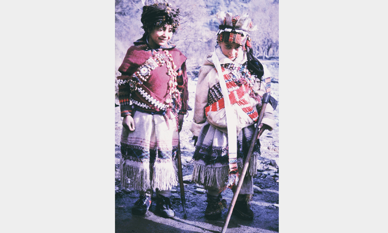 YOUNG boys dressed up in their ancestor clothes for the rite of passage.—Photo by writer