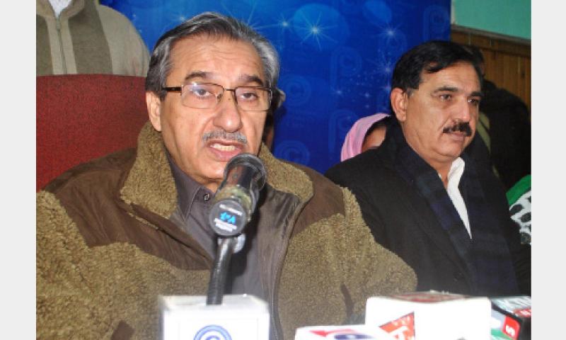 PPP leader Pir Mazharul Haq addresses mediapersons at Peshawar Press Club on Monday. — Online
