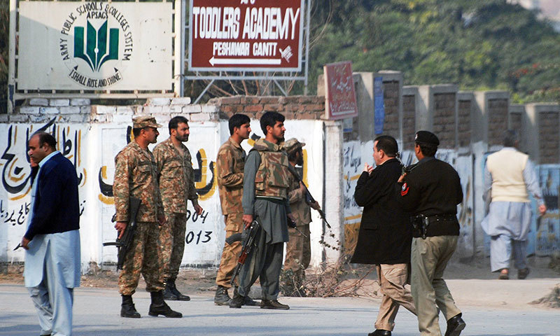 Security forces personnel at a road near the Army Public School, Peshawar. — Reuters/File