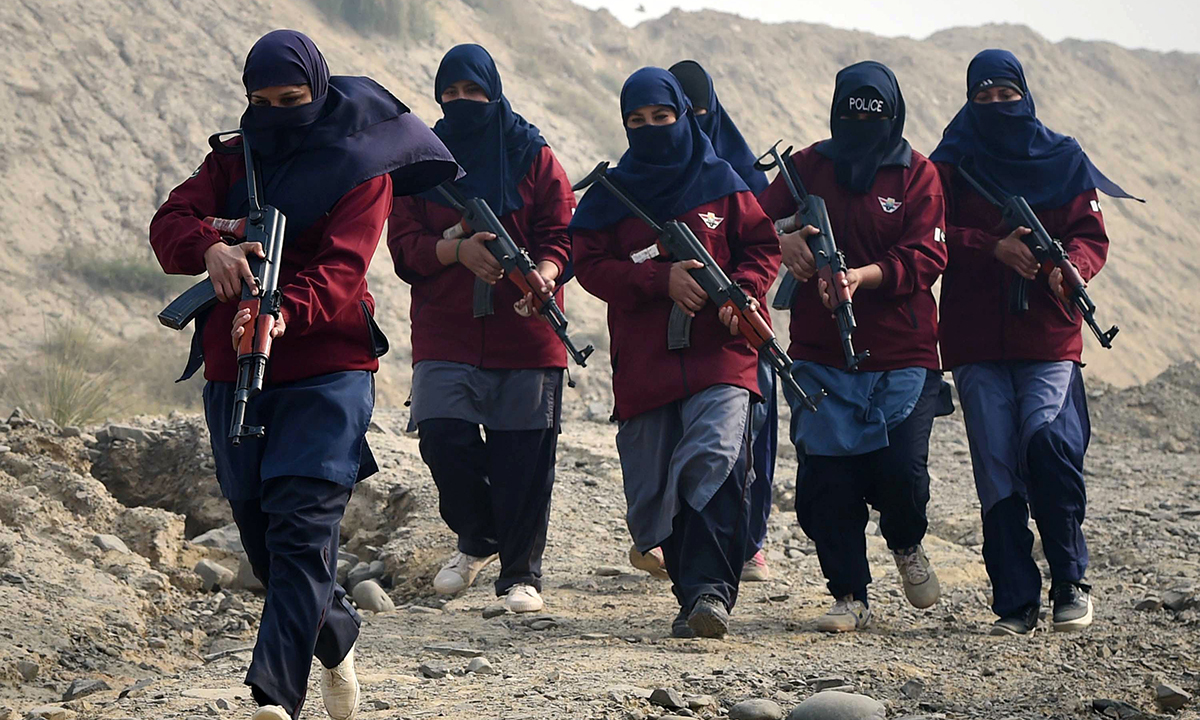 Female police commandos during an exercise at a police training centre in Nowshera, a district in the Khyber Pakhtunkhwa province. — AFP
