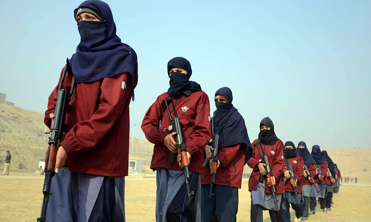 Female police commandos wielding their weapons during an exercise at a police training centre in Nowshera. — AFP