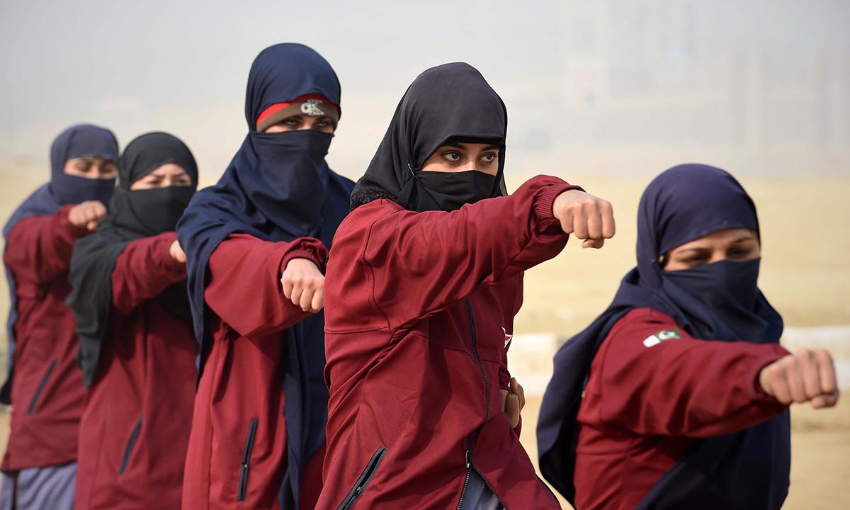 Female police commandos during training. — AFP