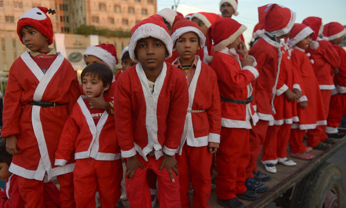 Children dressed as Santa Claus also participated in the Christmas peace rally.— AFP