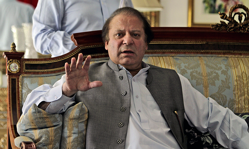 Prime Minister Nawaz Sharif gestures while speaking to members of the media. — AP/File