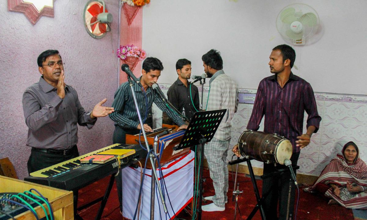 A church ban performs before prayers. — Affan Shah
