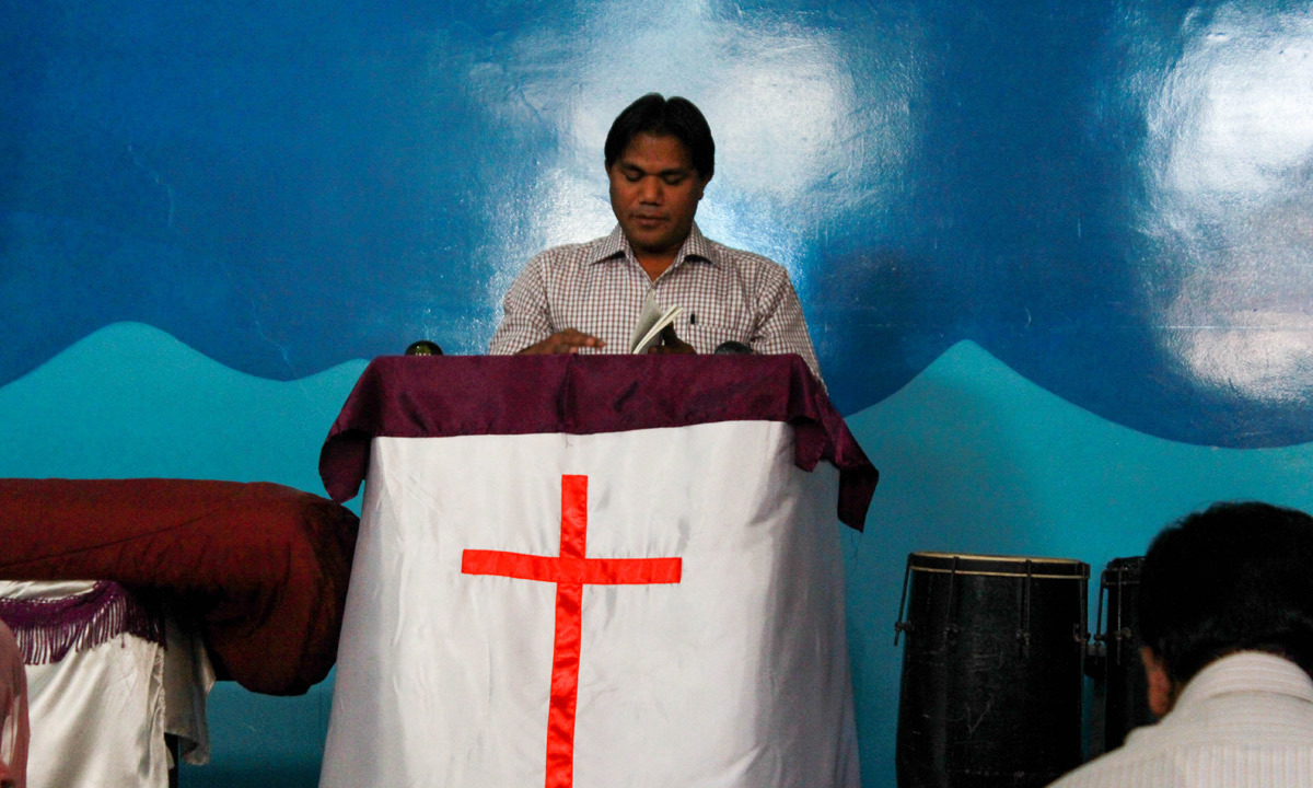A pastor leads a prayer at one of the churches. — Affan Shah