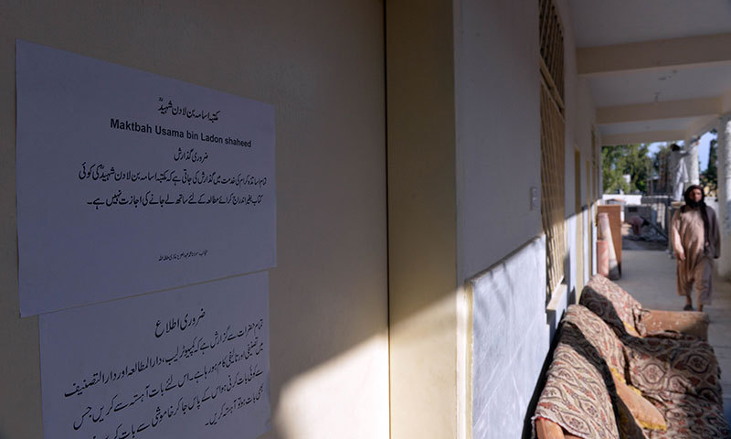 File photo shows a student walking past a door of a library named after slain al Qaeda leader Osama bin Laden at a Jamia Hafsa seminary in Islamabad.— File photo