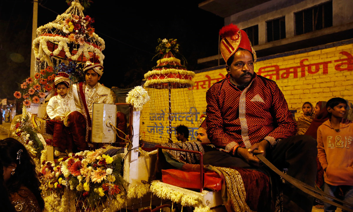 A Member Of Indian Brass Band Specialized Playing In Weddings Wait On Buggy