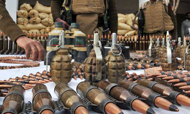 Security personnel display arms and ammunition recovered from militants. – AFP/File