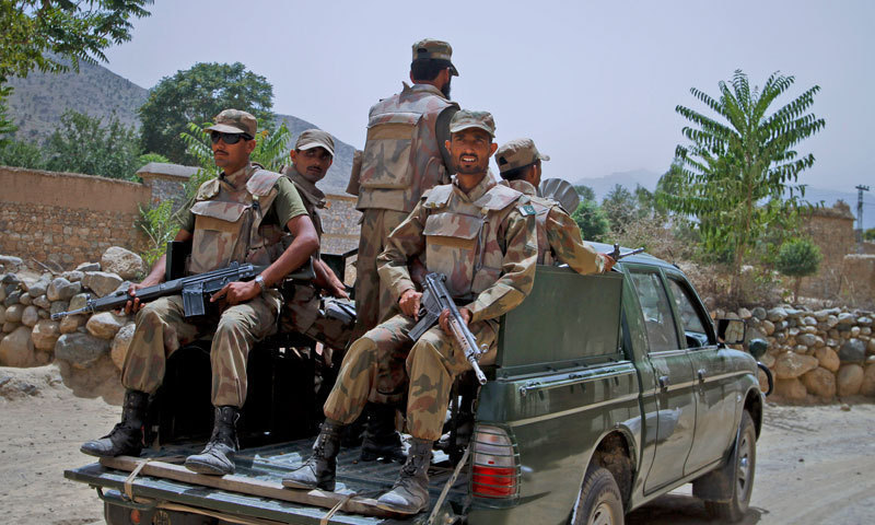 This picture shows security personnel patrolling a road in Balochistan. — INP/File