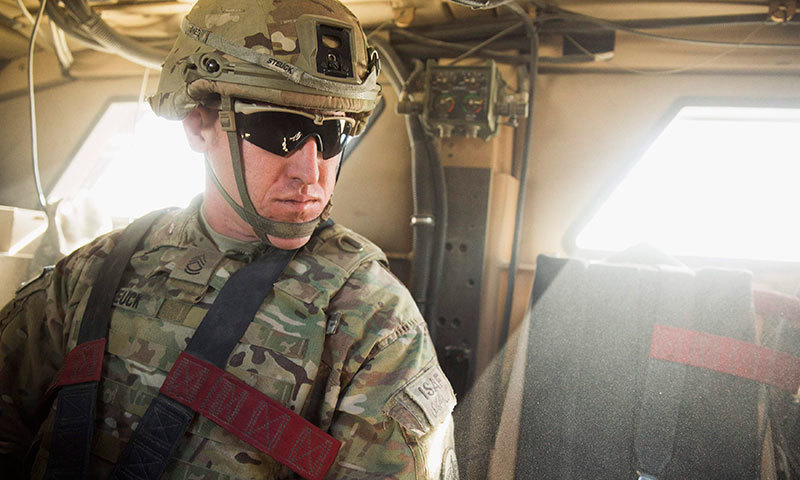 A US soldier from Dragon Company of the 3rd Cavalry Regiment rides in an MRAP vehicle near forward operating base Gamberi in the Laghman province of Afghanistan, December 26, 2014. - Reuters