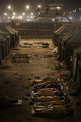 Iraqi detainees sleeping outside their tents in Camp Bucca, Iraq. — Photo by AFP