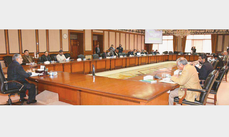 """Finance Minister Ishaq Dar chairing an Economic Coordination Committee meeting at PM's Office Islamabad on December 24. A case study by Zunia Saif Tirmazee and Mariyiam Haroon of Lahore School of Economics reveals that """"the concentration curves got steeper over time which is indicative of efficiency without equity""""."""