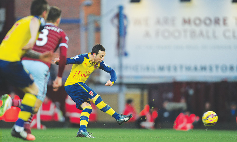 LONDON: Arsenal's Santi Cazorla scores from the penalty spot during the English Premier League match against West Ham United at Upton Park on Sunday.—AP