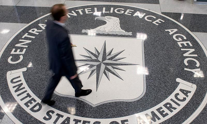 This August 14, 2008 photo shows a man as he crosses the Central Intelligence Agency (CIA) logo in the lobby of CIA Headquarters in Langley, Virginia. — AFP/File