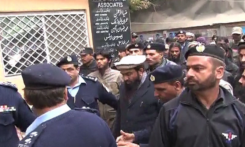 Zakiur Rehman Lakhvi is being taken to a local court in Islamabad.  - DawnNews screengrab