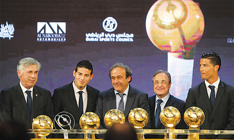 Dubai: UEFA president Michel Platini (C) poses alongside (L to R) Real Madrid manager Carlo Ancelotti, midfielder James Rodriguez, president Florentino Perez and star attacker Cristiano Ronaldo at the Globe Soccer awards ceremony.—AFP