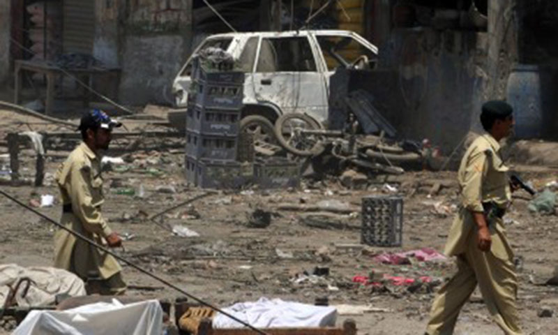 Paramilitary soldiers patrol a blast site in the district of Mohmand. —AFP/File