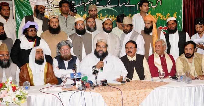 Pakistan Ulema Council (PUC) Chairman Allama Tahir Ashrafi addresses during a press conference.—Online/File