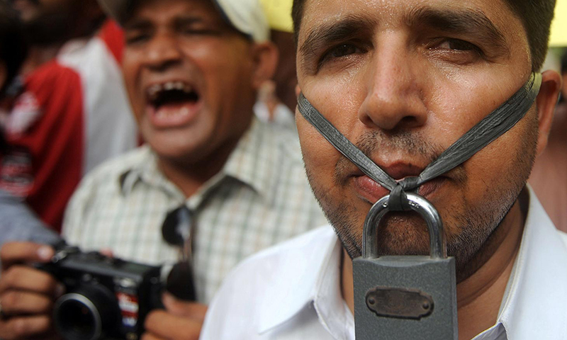 In this photo, journalists stage a demonstration during a protest in Karachi against the killing of Saleem Shahzad. — AFP/File