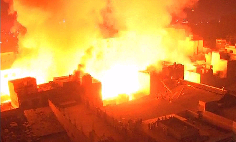 In this representative image, a fire could be seen sweeping through Karachi's timber market. — DawnNews screengrab