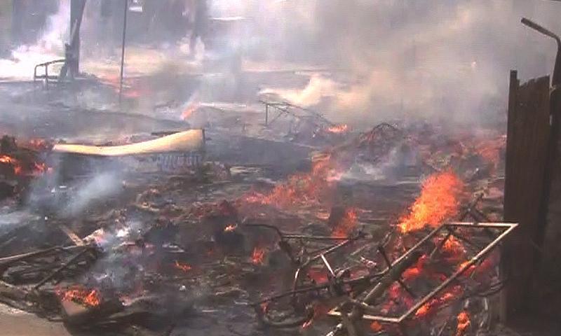 A fire could be seen sweeping through a furniture market in Karachi's area of Gulistan-i-Johar. — DawnNews screengrab