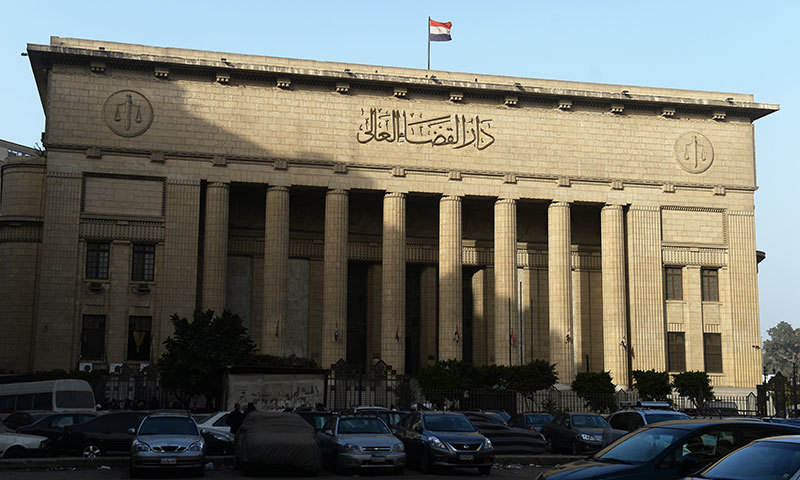 A picture shows Egypt's High Court in downtown Cairo, during the hearing of three Al-Jazeera reporters on charges of aiding the Muslim Brotherhood. -AFP Photo