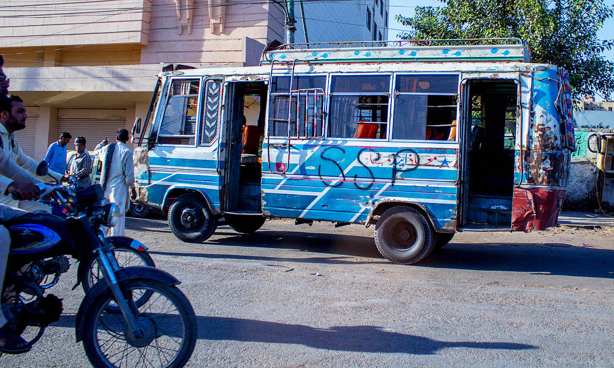 This bus wasn't fast enough for banned religious outfit Sipahe Sahaba Pakistan's supporter. — Photo by Muhammad Umar