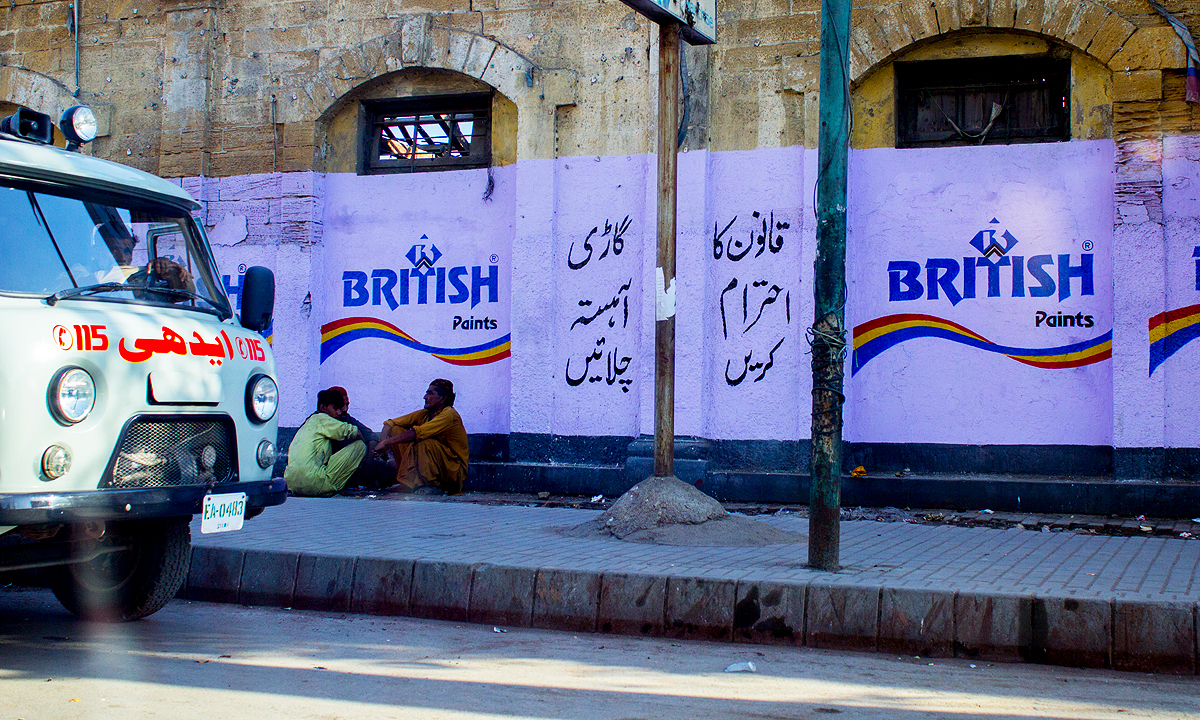 A British-era building is plastered with a British Paints public service message which calls on citizens to obey the law. — Photo by Muhammad Umar