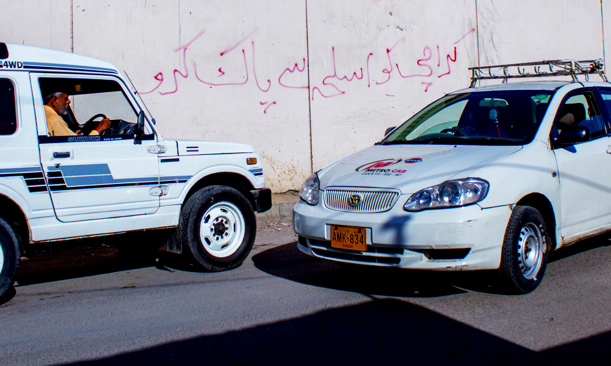 'Rid Karachi of weapons,' the message reads. — Photo by Muhammad Umar