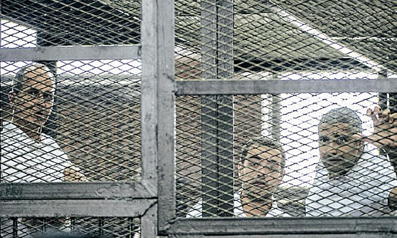 Convicted journalists: Peter Greste (left), Mohamed Fadel Fahmy (right) and Baher Mohamed. — AFP/File