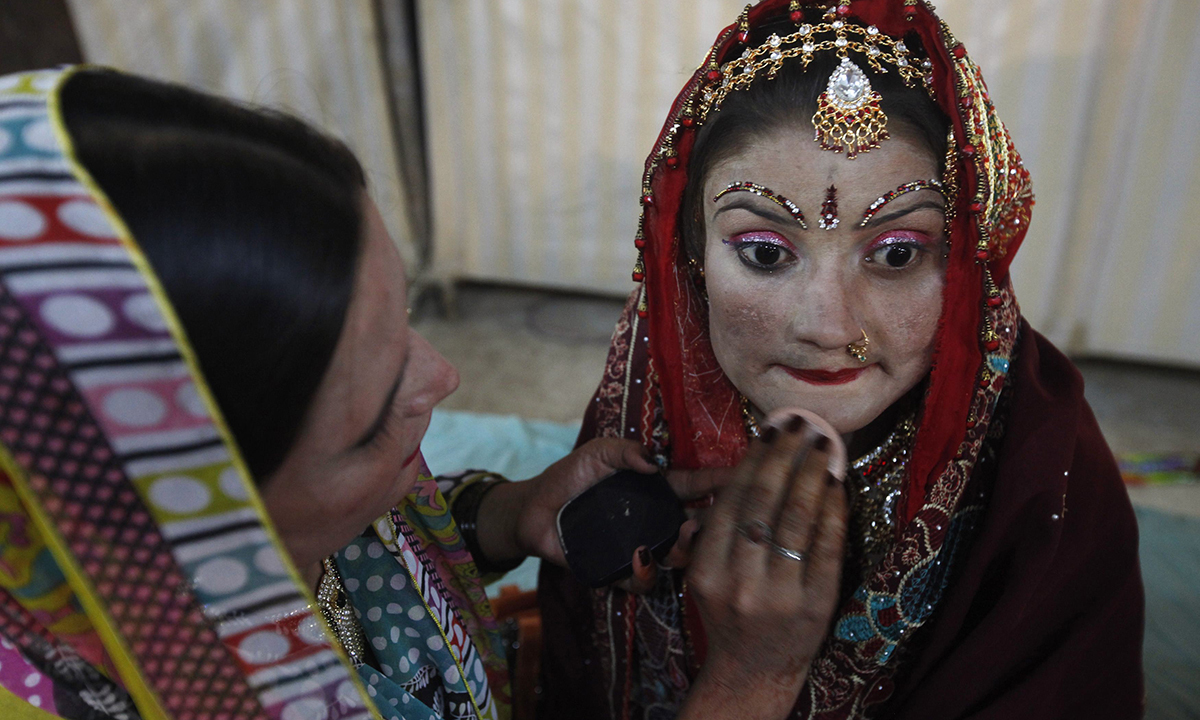 A bride gets ready for the wedding ceremony. — Reuters