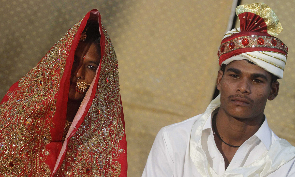 A bride and groom at a mass marriage ceremony. — Reuters