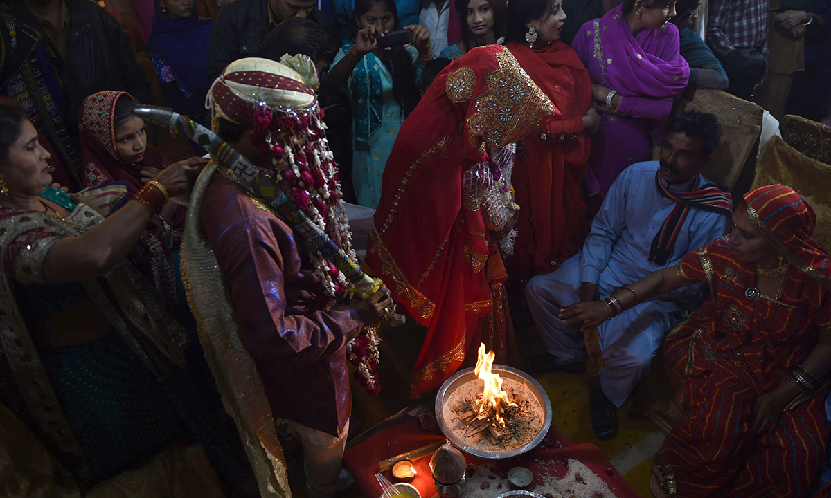 A  couple performs Hindu rituals. — AFP