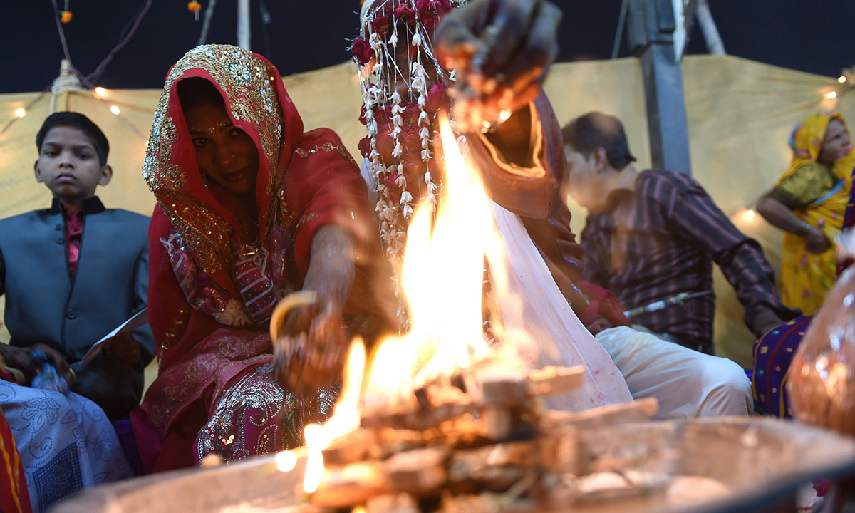 Rituals are performed at the wedding. — AFP