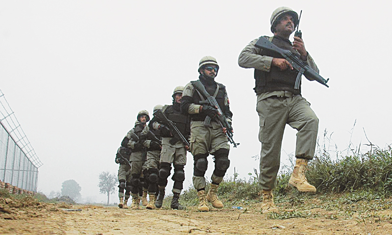 LAHORE: Pakistani troops march along the Zero Line at the Wagah Border on Saturday. Security forces are on high alert in view of relentless shelling by India in Shakargarh sector.—Online